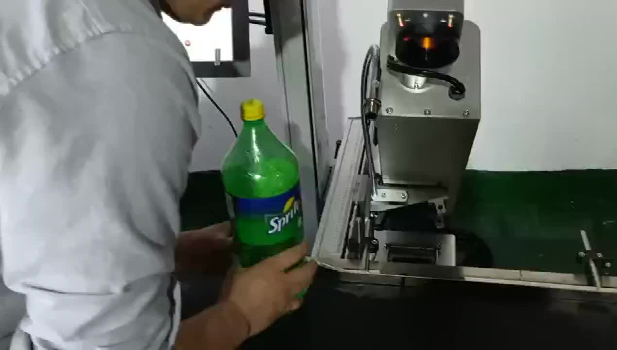 co2 printer laser coding machine for plastic on pet water bottle with expiry date