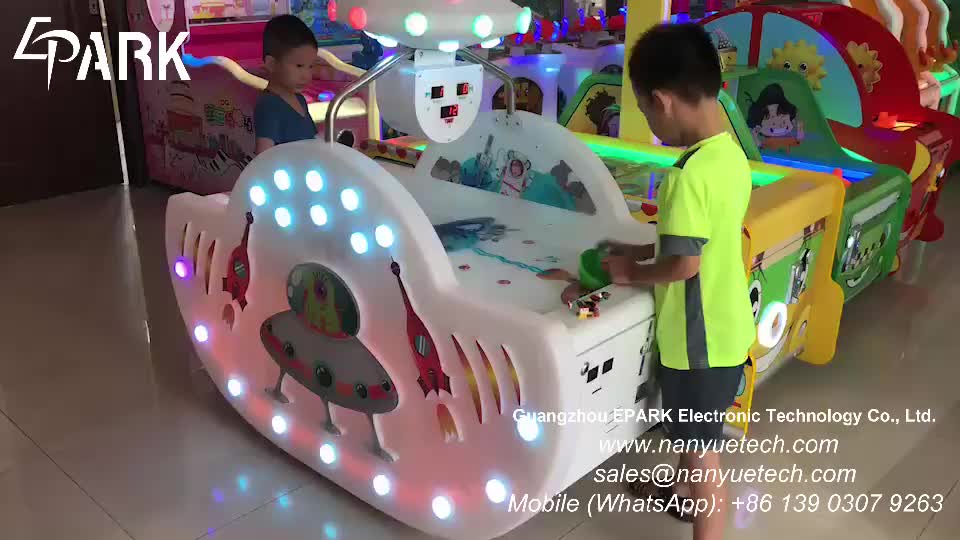 Coin operated UFO air hockey amusement game machine