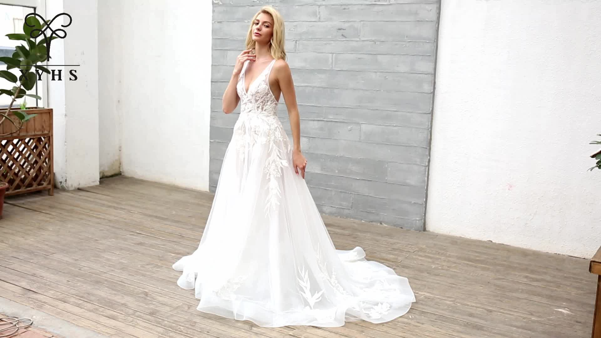 Hot sale A line wedding dress 2019 deep v neck sleeveless beading lace applique backless slip tulle bridal gown