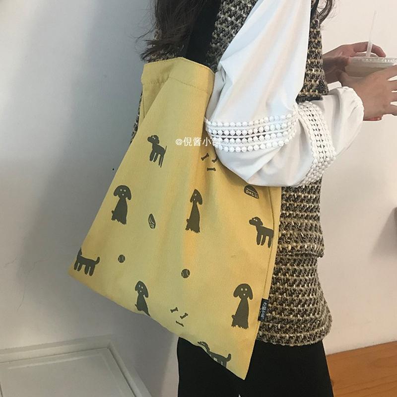 倪醬小鋪 黑狗的假期日系文藝百搭帆布袋學生ins單肩帆布包女斜挎
