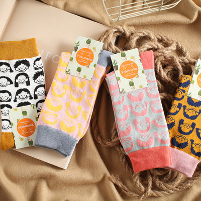 Japanese and Korean personality pop style cute face cotton long socks ladies sweat-absorbent cartoon pop jacquard tube socks