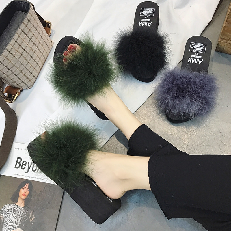Korean version of the fashion fur thick-soled slippers female summer flat bottom slope with a word drag students sponge cake wear wild women's shoes