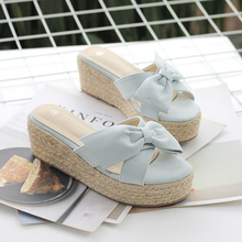 Straw-woven Fairy Wind Slippers for Women Wearing New Summer 2019 Flat-soled Slope-heeled Butterfly-knotted Thick-soled Sandals