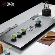 Source rhyme Natural monolithic ebony tea tray Small large black stone tea tea sea drain Kung Fu tea set