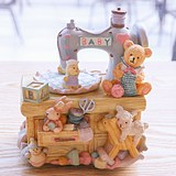 Sewing machine bear music box carousel eight-tone box to send girls and children children honey Christmas birthday gift