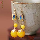 Chinese style amber eardrop chicken oil yellow and old wax earring made of cloisonne
