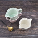 European simple color glazed ceramic belt put the sharp nipple milk pot milk pot milk pot coffee pot teapot juice jug 250ml