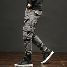 Buy spring and autumn jeans on behalf of men's fashion Japanese elastic large size Harun overalls with multi-pocket tides