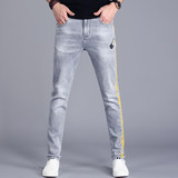 Broken hole embroidery flower jeans men's trend Slim feet pants casual Korean version of the tide brand wild casual stretch