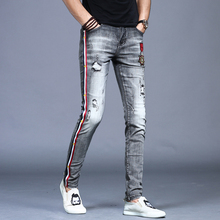 Summer thin pierced embroidered jeans Men's Chao brand, small feet Korean fashion casual pants Men's 100 sets