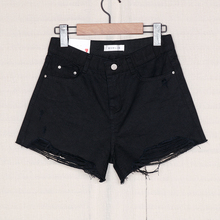 Korean howluk hollow denim shorts women's loose 2019 summer new high waist black wide legged hot pants 384