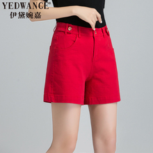 Women in big red jeans wearing high waist net red shorts