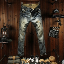 Spring and autumn holes in jeans men's self-cultivation small straight tube European and American personality retro youth fashion patch beggar pants