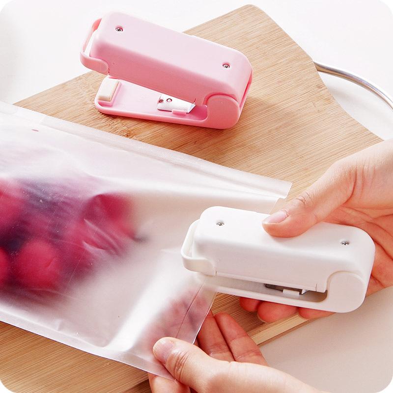 便携迷你零食食品保鲜封口机塑封机 旅行家用手压热封机封口器夹