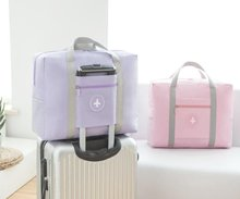 The bag for use on the luggage compartment of the travelling bag can be hung on a folding, backhand and placed place.