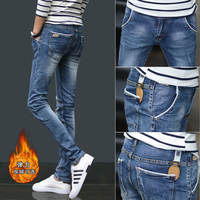 Autumn and winter thick men's jeans men's Korean version of the trend of elastic casual pants Slim straight feet and velvet trousers