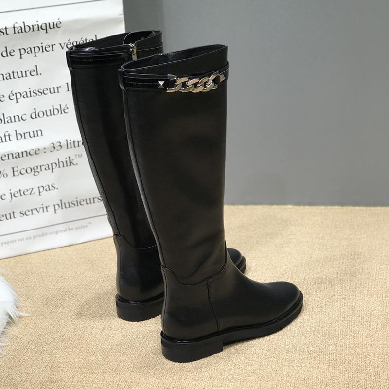 欧洲站冬季新款真皮长靴女平底低跟链条圆头侧拉链高筒骑士靴长筒