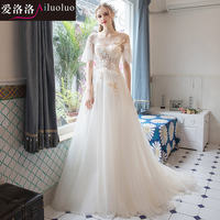 Love Luo Luo wedding 2019 new light champagne word shoulder trumpet sleeves small trailing wedding dress thin dream light wedding dress