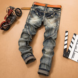 Europe and the United States retro jeans men's stitching 乞丐 old patch Slim straight long pants personality street brand locomotive