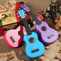 High quality solid wood 21 inch children's guitar Ukuleri toy music wooden small guitar beginners learning piano