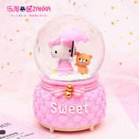 Send girl kt Hello Kitty snowflake rotating light luminous music box music box crystal ball creative birthday gift