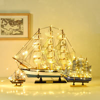 Nordic ins wind belt lights sailboat model ornaments smooth sailing small wooden boat solid wood simulation sailing decoration