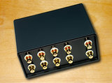 Gold-plated RCA socket for stereo four channel audio input with volume control and one channel output switcher