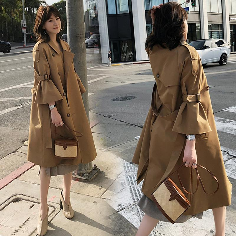 Thin windbreaker female long section autumn and winter khaki Korean version of the trumpet sleeves over the knee coat women