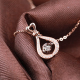 18K gold diamond pendant women's fashion simple and dynamic diamond necklace women's neck chain seven-night gift genuine diamond