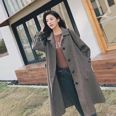 燕麦灰气质呢大衣女中长款2018秋冬新款英伦风系带人字纹毛呢外套