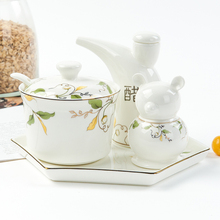 Tangshan bone china hotel seasoning set of vinegar pot, chili pot, hot pepper pot, toothpick, cage, small tray, tableware and cutlery.