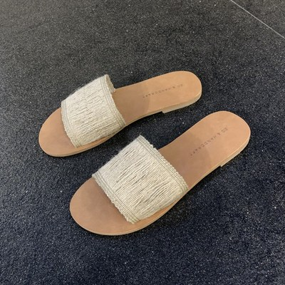 韩国东大门代购女鞋2019夏季新款露趾一字纯色编织平底个性凉拖鞋