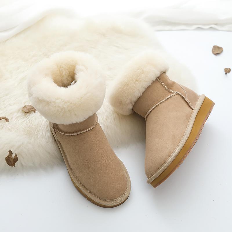 雪地靴女皮毛一体中筒女靴冬季情侣百搭真皮大码保暖加厚羊毛棉鞋