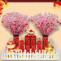 Chinese New Year shopping mall decoration sitting cannons and firecrackers ornaments New Year window peach tree New Year's Day scene layout new year decorations
