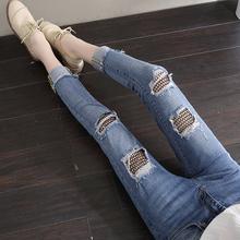 夏季韩版新款渔网拼接弹力破洞牛仔裤女九分显瘦七分小脚铅笔女裤