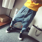 New Korean version of the men's personality exaggerated hanging harem jeans nine pants European and American style hip hop low pants tide