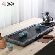 Household Wujinshi tea set tea table stone natural whole piece extra large rectangular drainage black gold stone tea sea