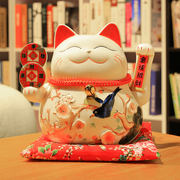 Lucky cat decoration home opening gift shop Japanese living room small electric rocking hand creative ceramic piggy bank