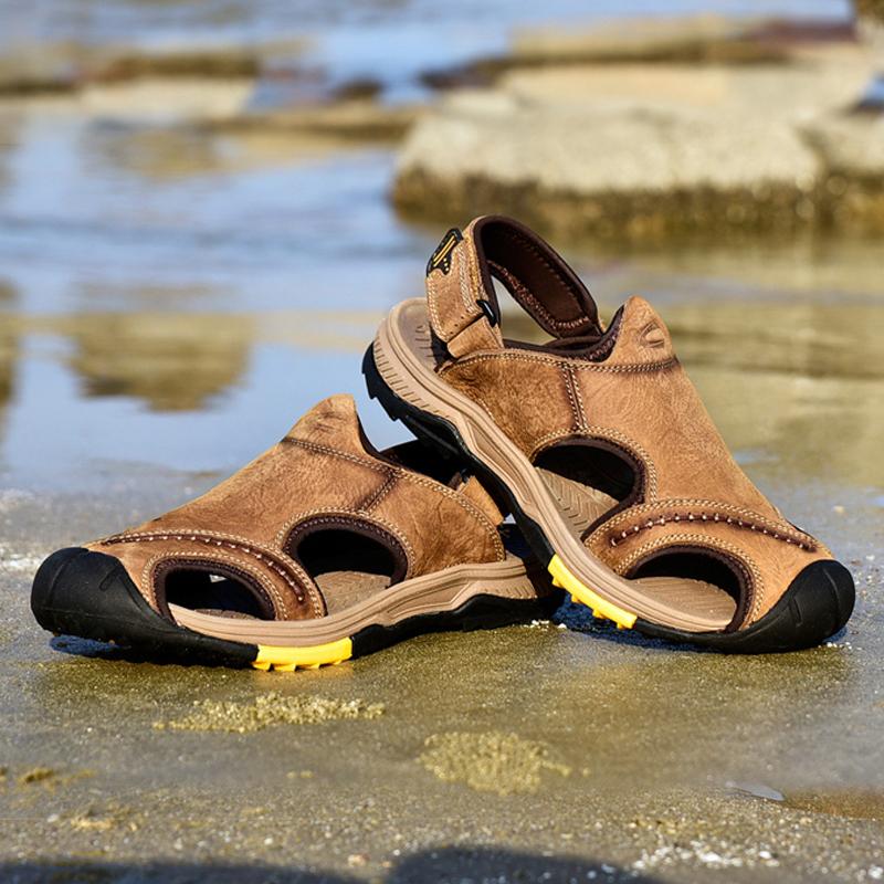 德國 駱駝正品男涼鞋新款戶外防撞真皮包頭沙灘鞋磨砂牛皮防滑鞋N
