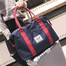 小行李包女短途旅行包男韩版帆布迷你轻便手提行李袋简约旅游包潮