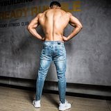 Jagged muscle fitness jeans male stretch Slim sports brothers dog casual 乞丐 hole small feet nine pants