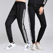 Lovers'sports pants, women's loose little feet, and men's cotton leisure pants with Harun's three bars and guards