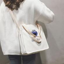 宽带包包女2018新款卡通可爱少女单肩包简约手提大容量帆布斜挎包