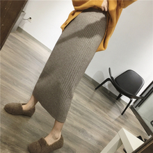 Fine rice knitted pit-strip half-length skirt Korean version of women's self-cultivation and thicker waist, slim package, hip split one-step skirt winter