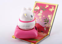 Counter genuine Sakura blessing lucky money cat solar shaking head doll hand can move rich cat