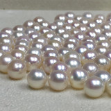 Slightly round natural white through pink Freshwater Pearls comparable to the Japanese akoya 7-9mm light