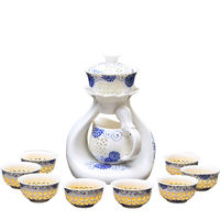 Tang Feng set of semi-automatic tea set home simple ceramic lazy teapot Kung Fu cup blue and white porcelain