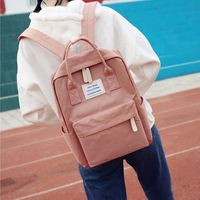 Harajuku simple waterproof canvas backpack small fresh female Korean version of the college wind bag student ins super fire backpack